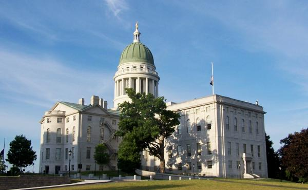 The Maine Legislature established a high-risk pool for insuring patients with expensive medical conditions, partly funded with a surcharge on all policyholders in the state.