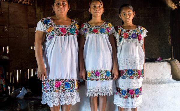 Maria de los Angeles Tun Burgos with daughters Angela, 12, and Gelmy, 9, in their family home in a Mayan village in Yucatan, Mexico.
