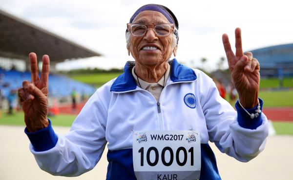 Man Kaur of India celebrates after competing in the 100-meter sprint in the 100+ age category at the World Masters Games in Auckland, New Zealand, in April 2017.