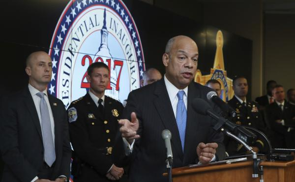 Homeland Security Secretary Jeh Johnson, along with other law enforcement officials taking part in security preparations for President-elect Donald Trump's inauguration, hold a briefing on Friday.
