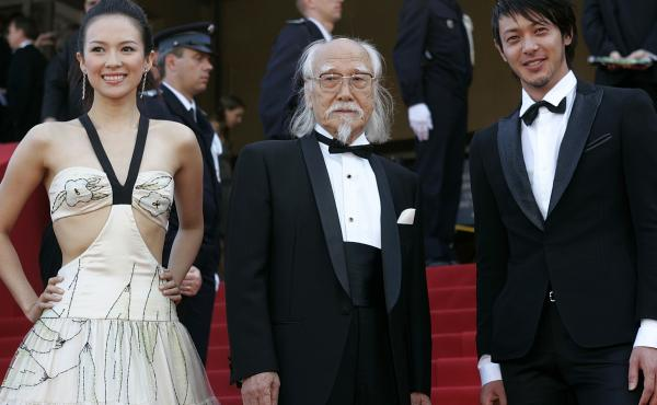 Director Seijun Suzuki, center, died last week at age 93. He's seen here with actors Zhang Ziyi, left, and Joe Odagiri, right, as they arrive for a screening at the Cannes film festival in 2005.