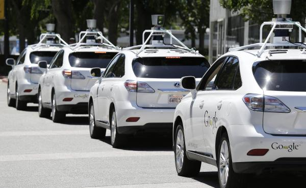 Google self-driving cars are shown outside the Computer History Museum in Mountain View, Calif., in May 2014.