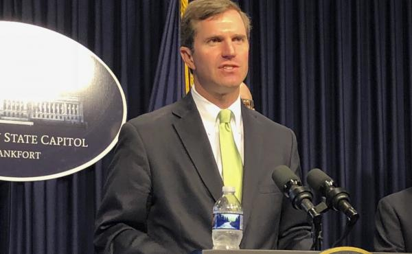Kentucky Gov. Andy Beshear, seen last week, defended round-the-clock surveillance of a man who allegedly tested positive for coronavirus and wouldn't self-isolate.