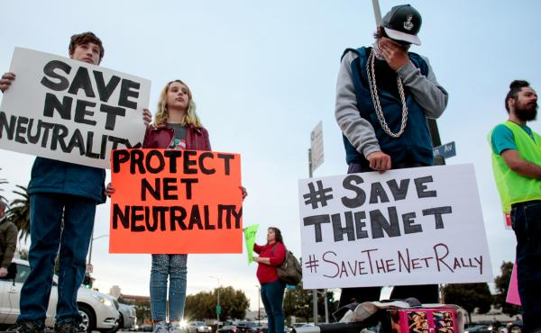 Senate Democrats say they have the votes to formally disapprove of the FCC's Internet policy that will take effect next month. Here, supporters of net neutrality protest the decision to repeal the Obama-era rule.