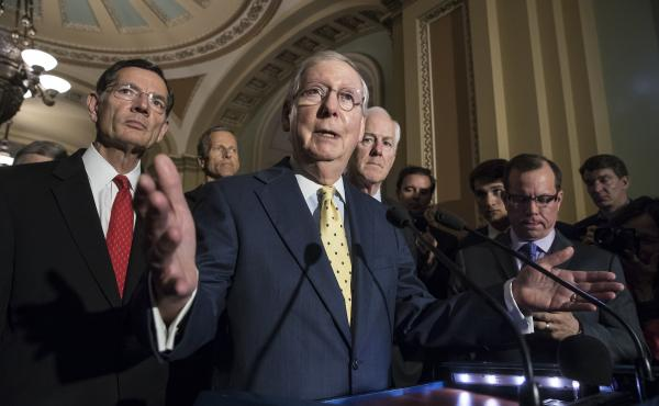 Senate Majority Leader Mitch McConnell, joined by other Republican senators, meets with reporters following a closed-door strategy session at the Capitol on Tuesday.