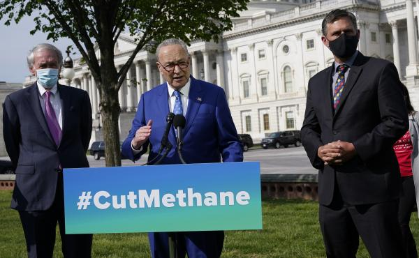 Senate Majority Leader Chuck Schumer, joined by Sens. Ed Markey (left) and Martin Heinrich, discusses legislation Wednesday to reimpose regulations to reduce methane pollution from oil and gas wells.