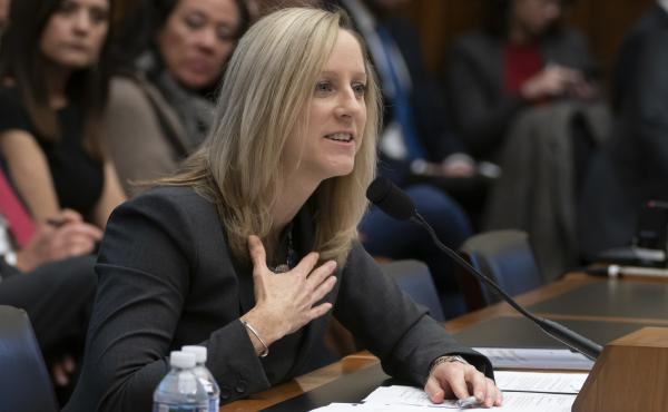 Kathleen Kraninger, director of the Consumer Financial Protection Bureau, testifies before the House Financial Services Committee on March 7. On Thursday, she faced questions from senators about problems with a student loan program for public service work