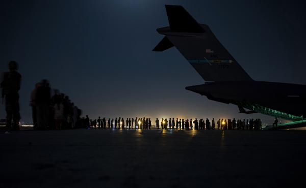 A U.S. Air Force air crew prepares to load evacuees aboard a C-17 aircraft at Hamid Karzai International Airport in Kabul, Afghanistan, on Aug. 31. Several public school students from Sacramento, Calif., remain in Afghanistan since the U.S. evacuation end