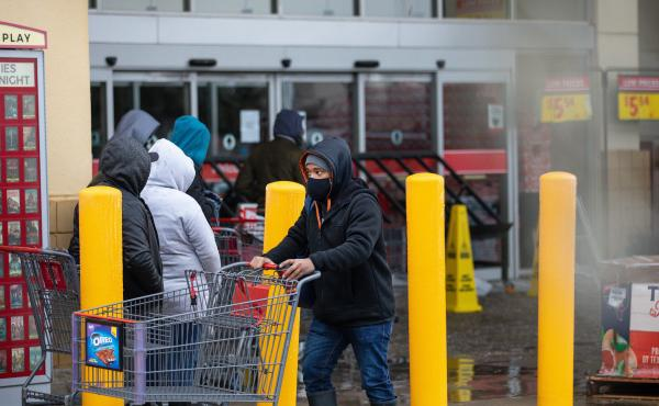 """People wait in long lines at an H-E-B grocery store in Austin, Texas, on Wednesday. The large supermarket chain said the """"unprecedented weather event in Texas has caused a severe disruption in the food supply chain."""""""