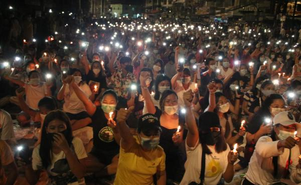 Protesters against last month's military coup hold a candlelight rally in Yangon, Myanmar, on  Saturday. More than 70 people have been killed by security forces since the military overthrew the country's fragile democracy six weeks ago, a United Nations o