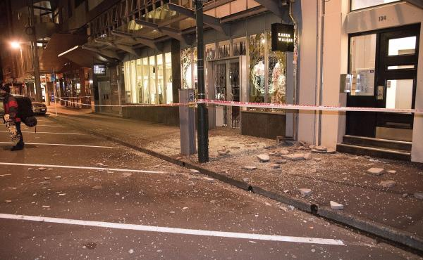 Debris from fallen concrete off buildings lies on the sidewalk in Wellington, after a powerful earthquake rocked New Zealand. The U.S. Geological Survey reports the quake had a 7.8 magnitude.