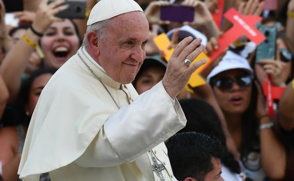 Pope Francis waves to a crowd as he arrives at the National Shrine of Maipu in Santiago, Chile, to meet with young people, on Wednesday.