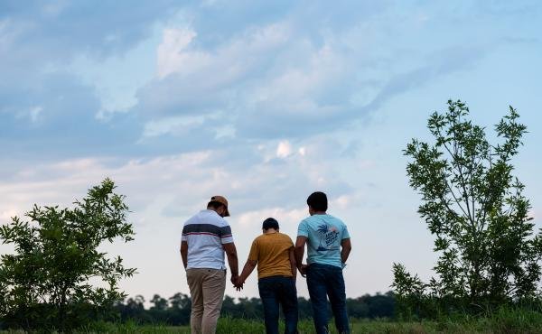 Honduran migrants, Ricardo Sr., (left), his son Ricardo Jr., 13, and his cousin Jorge, 16, walk near their home in Texas. When the two teenage boys crossed the border illegally into Texas last month, they turned themselves in to the Border Patrol. They we