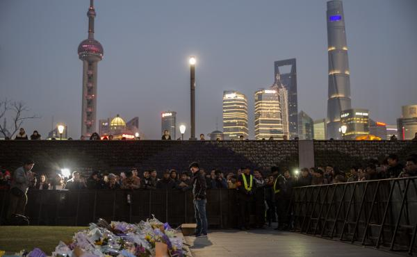 On Jan. 1, people gathered at a makeshift memorial marking the site of a New Year's Eve stampede on the Bund in Shanghai, China. Three dozen people died, and dozens more were injured.