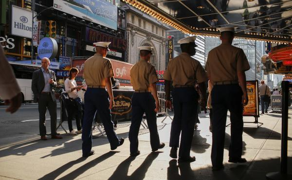 Marines walk around Times Square during Fleet Week on May 25, 2016 in New York City. A Pentagon investigation is under way into the posting of hundreds, and perhaps thousands, of nude photos of female Marines.