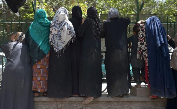 Internally displaced Afghan women, who fled because of battling between the Taliban and Afghan security forces, gather at Shahr-e-Naw Park in Kabul on Aug. 13.