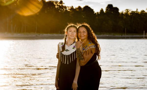 Danita Bilozaze, alongside her daughter Dani, celebrated the completion of her master's degree in education with a portrait session last year at Kye Bay in Comox Valley, British Columbia. Bilozaze's studies focused on Indigenous language revitalization.