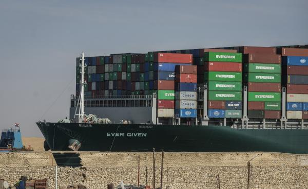 The Ever Given container ship, operated by the Evergreen Marine Corp., sails through the Suez Canal after it was fully freed and floated on Friday.