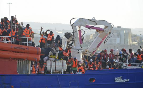 The ship operated by German aid group Mission Lifeline, carrying 234 migrants, arrives at the Valletta port in Malta on Wednesday, after a journey of nearly a week while awaiting permission to make landfall.