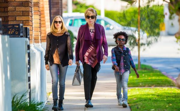 Ok it'd be awesome if that car behind them exploded right now (spoiler: it won't). L to R: Amanda Seyfried, Shirley MacLaine, AnnJewel Lee Dixon in The Last Word.