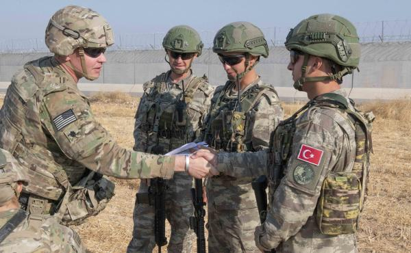 U.S. allies in the Syrian Democratic Forces say the White House's decision to pull troops from the Syria-Turkey border has left them without hope. Here, a U.S. soldier is seen during a joint patrol with Turkish troops on Friday.
