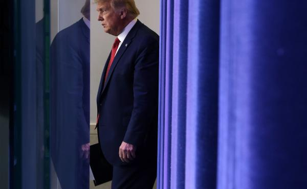President Trump walks up to speak during a news conference Monday, minutes before being interrupted by news of a shooting outside the White House.