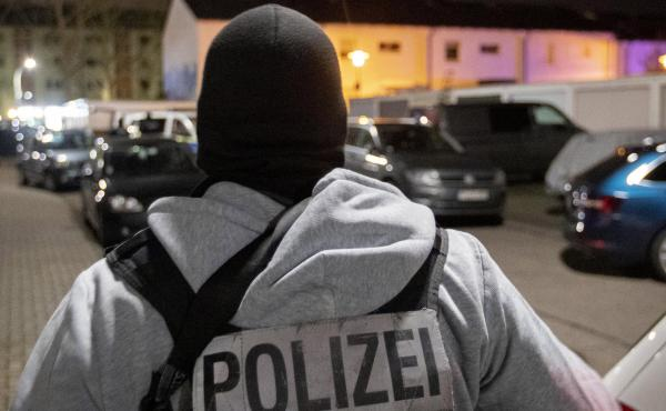 A police officer guards the road in front of a house where police found the bodies of the suspected gunman and his mother, in Hanau, Germany, on Thursday.