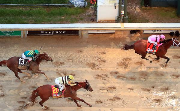 Maximum Security (right) and Country House (center) at the finish line of the 145th running of the Kentucky Derby at Churchill Downs last month in Louisville, Ky.