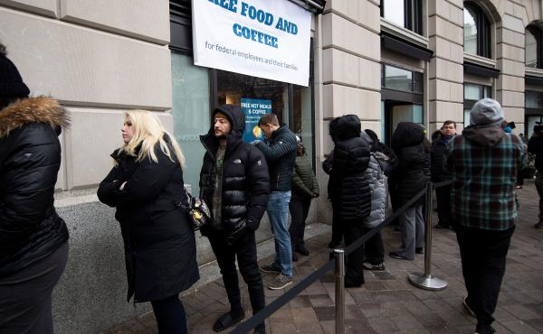 Federal workers stand in line for a free hot meal in Washington, D.C., on Wednesday.