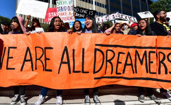Students and supporters of the Deferred Action for Childhood Arrivals rally in downtown Los Angeles in November while the U.S. Supreme Court heard arguments about the program. The court's ruling Thursday will uphold DACA for now.