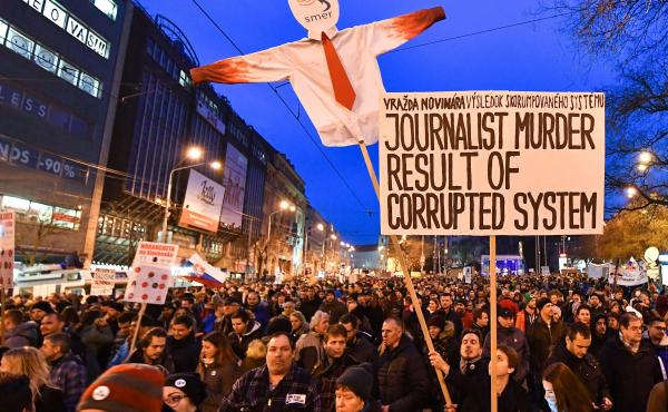 Protesters holds placards during a rally last week to pay tribute to murdered Slovak journalist Jan Kuciak and his fiancee Martina Kusnirova at the Slovak National Uprising (SNP) square in Bratislava.