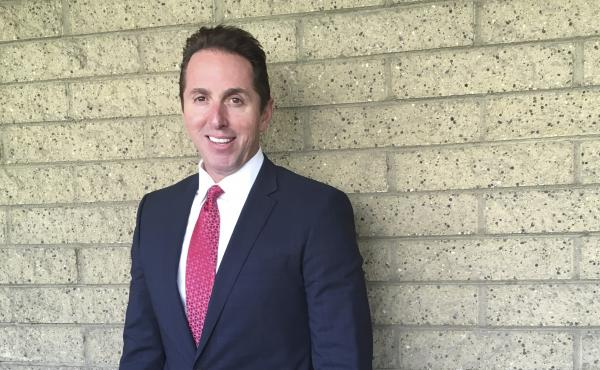 The city council in Los Alamitos, Calif., has given its preliminary approval to a measure exempting the city from a state law that limits cooperation between local police and federal immigration agents. Mayor Troy Edgar is seen here on Monday outside Los