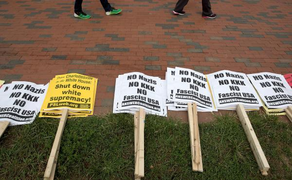 "Anti-KKK signs laid out by counterprotesters in Lafayette Square on Sunday ahead of a planned white supremacist ""Unite the Right"" rally across from the White House."