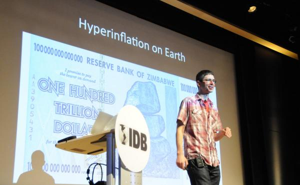 "Yoram Bauman jokes about ""hyperinflation in hell"" and on earth. Case in point: the Zimbabwe hundred-trillion-dollar note."