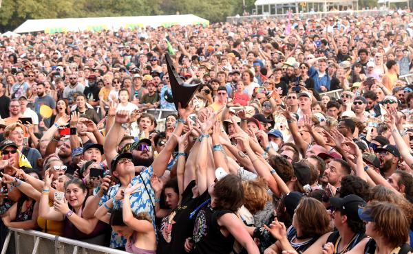 The crowd catches Wes Borland's guitar during the Lollapalooza music festival last weekend at Grant Park in Chicago.