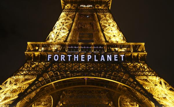 """The slogan """"For The Planet"""" is projected on the Eiffel Tower as part of the United Nations Climate Change Conference in Paris in December 2015."""