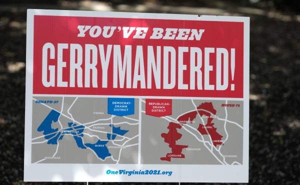 Redistricting reform advocates in Virginia pitched the creation of a new commission as a remedy to unfair political maps, like the ones shown on this poster from 2019, but the new group has struggled to reach consensus.