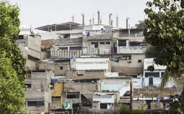 Social distancing is a challenge in tightly packed slum neighborhoods, like this one in Karachi, Pakistan.