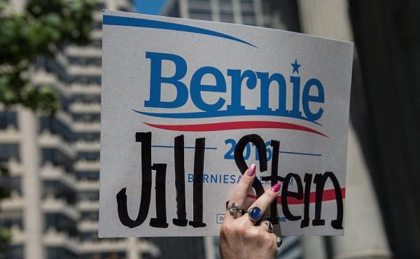 A supporter of Green Party candidate Jill Stein holds a doctored Bernie Sanders sign at a rally at City Hall in Philadelphia during the Democratic National Convention last month.
