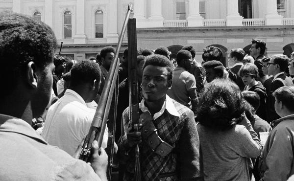 Armed members of the Black Panther Party leave the Capitol in Sacramento May 2, 1967. The Panthers entered the Capitol fully armed and said they were protesting a bill before the Legislature restricting the carrying of arms in public.