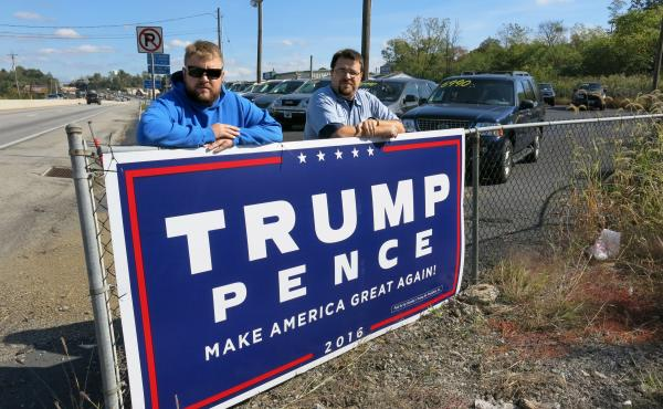 Adam Miller, 28, and Robert Miller, 32, placed a 4-by-8 Trump campaign sign on their family's used car lot in Dillsburg, Pa. The two men say they feel disenfranchised in a country that is becoming more diverse. Both say they believe their lives will be be