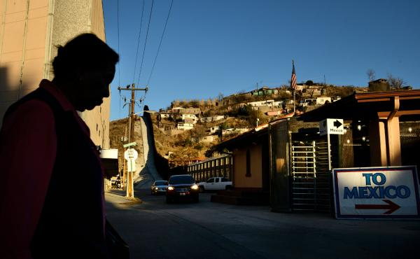 A woman walks toward the international crossing gate in Nogales, Ariz., in March 2013.