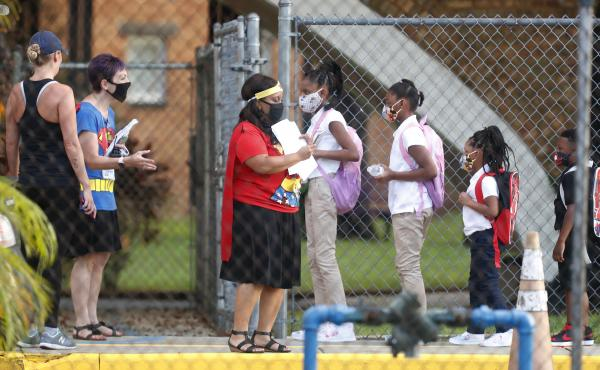 Students return to school at Seminole Heights Elementary in Tampa on Aug. 31, 2020, after the Florida Department of Education mandated in-class learning.
