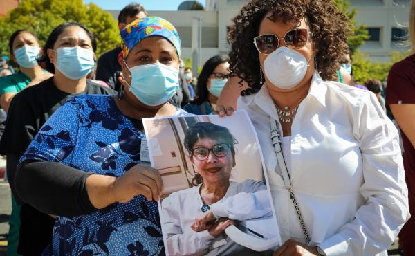 Worried registered nurses held a vigil in July at Sutter Health's Alta Bates Summit Medical Center in Oakland, Calif., to remember their colleague Janine Paiste-Ponder, who caught the coronavirus, likely from a patient, and died from complications.