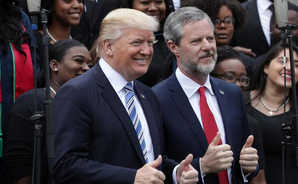 President Trump poses with Liberty University President Jerry Falwell Jr., during commencement at Liberty University May 13 in Lynchburg, Va.