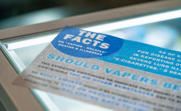 A flyer reminding customers about vaping-related deaths and illnesses, on display in a Seattle vape store. The Washington State Board of Health recently passed a four-month emergency ban on flavored vaping products. It applies to products that contain eit