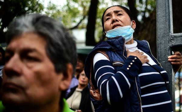 Relatives of people who are presumed still buried beneath the rubble await news of rescue efforts in Mexico City on Tuesday.