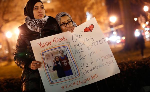Kheira Benkreira and Hasnia Bekkadja attend a vigil for the slain Chapel Hill victims in Washington, D.C., last week.