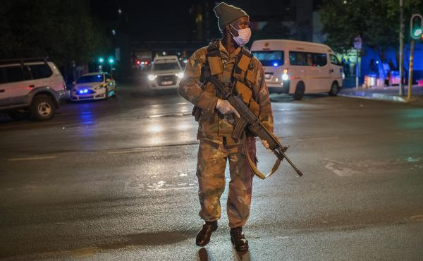 A South African soldier enforces the lockdown order in downtown Johannesburg on Friday.