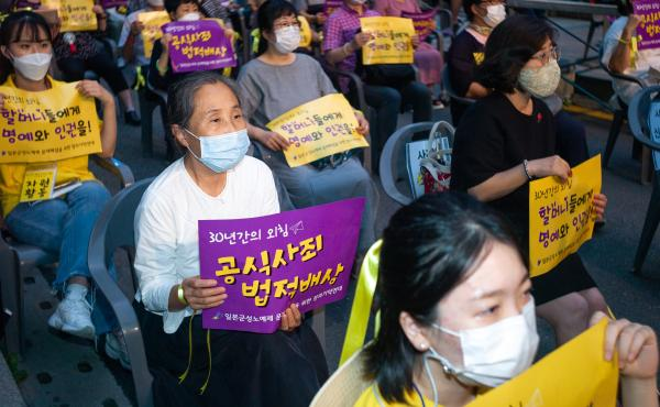 Hundreds of people gather for a rally to mark the International Memorial Day for Comfort Women on August 14, 2020 in Seoul, South Korea. A South Korean court recently ordered Japan to financially compensate 12 women forced into sexual slavery by the Japan